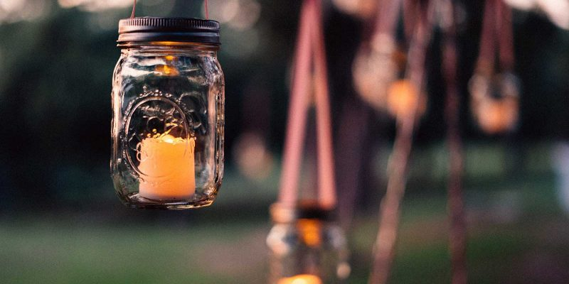 Jar lamp hanging from a tree